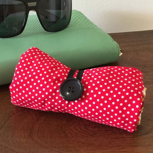 Red oriental Reusable Grocery Bag all rolled up - Andrie Designs