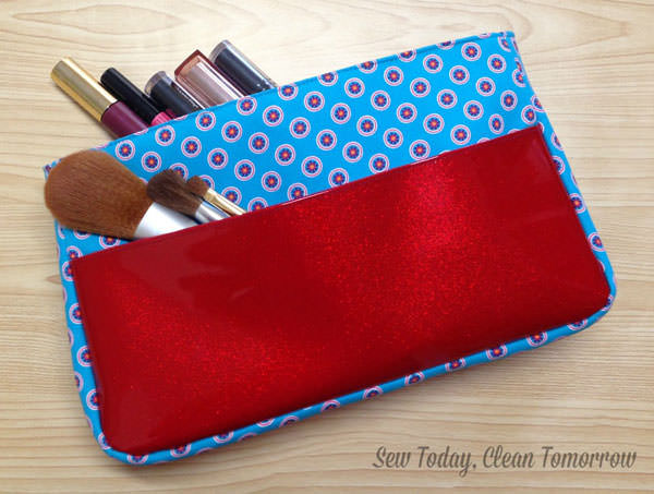 Look how great that red glitter vinyl outer pocket pops! Carry All Flexi Clutch - Andrie Designs