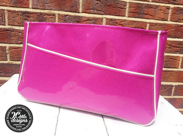 Bright pink glitter vinyl was used for this Carry All Flexi Clutch - Andrie Designs