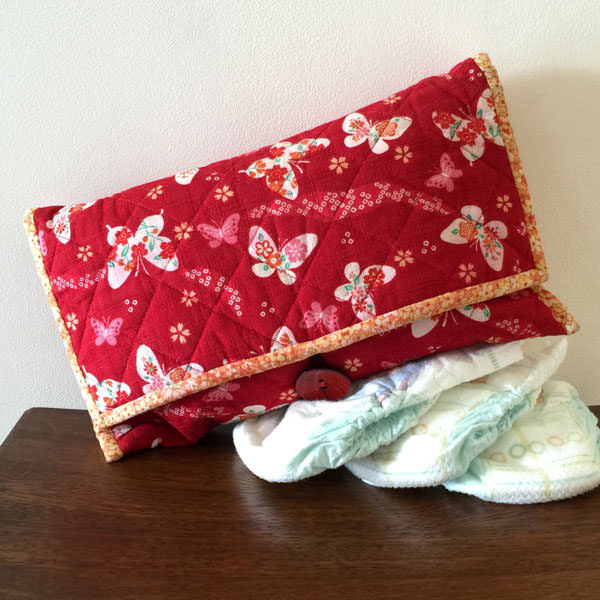 Red with butterflies Essential Diaper Clutch - Andrie Designs