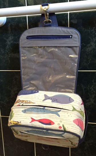 Inside of the fishing-themed Hang About Toiletry Bag - Andrie Designs