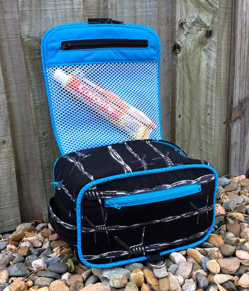 Inside the black barbed wire Hang About Toiletry Bag - Andrie Designs