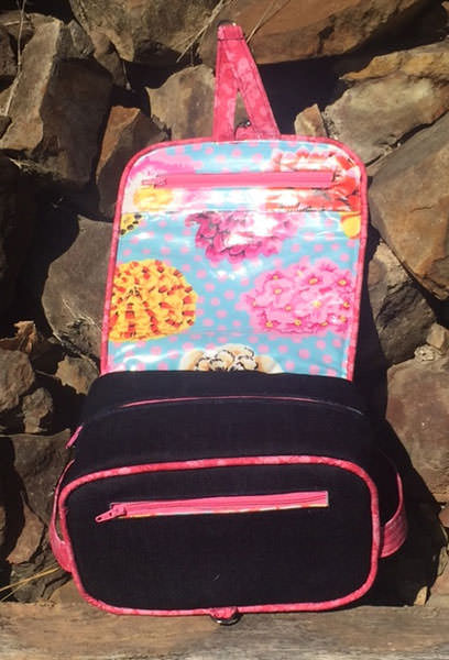 Inside view of the denim and pink Hang About Toiletry Bag - Andrie Designs