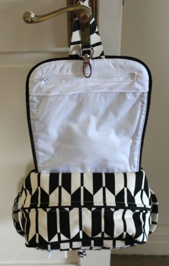 Inside the classic black and white Hang About Toiletry Bag - Andrie Designs