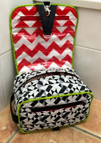 Inside the black, white with a pop of lime green Hang About Toiletry Bag - Andrie Designs
