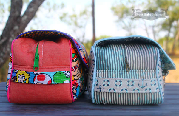 Side view of both sizes of the Hang About Toiletry Bag - Andrie Designs