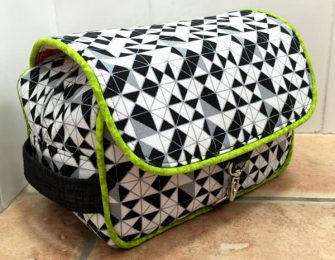 Black, white with a pop of lime green Hang About Toiletry Bag - Andrie Designs