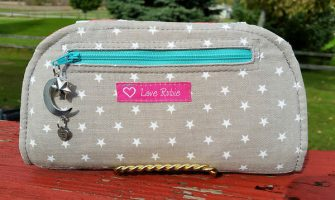 Back view of the grey and feathers Cleo Everyday Wallet - Andrie Designs