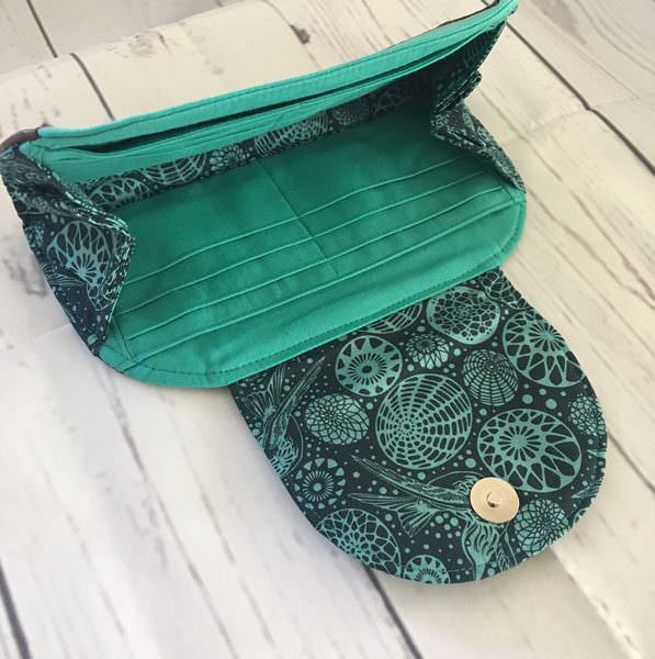 Inside the mint green and brown leather Cleo Everyday Wallet - Andrie Designs