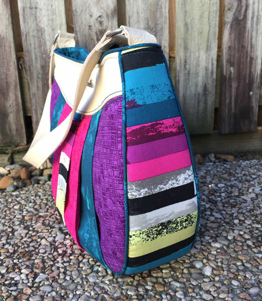 Side view of the narrow pieced front Sew Compleat Shoulder Tote - Andrie Designs