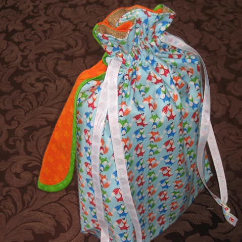 Check out the orange cape on this Super Drawstring Pouch - Andrie Designs