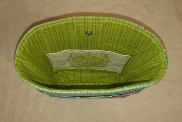 Inside of the sewing-themed Stand Up Clutch - Andrie Designs