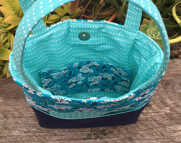 Inside the teal and navy Stand Up Clutch - Andrie Designs