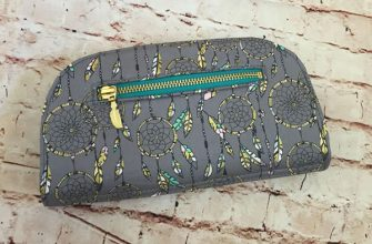 Back view of the gold and feathers Cleo Everyday Wallet - Andrie Designs