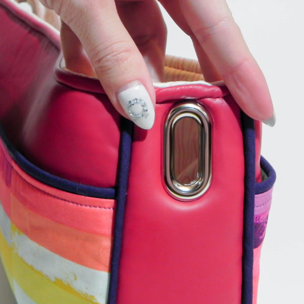 Close up of grommet - Carry All Flexi Clutch - Adding a Shoulder Strap: Option #3 - Andrie Designs