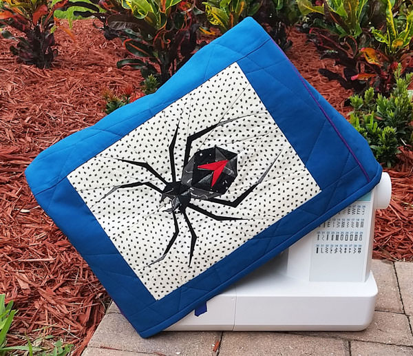 Check out that paper pieced spider! Made For Me Sewing Machine Cover - Andrie Designs