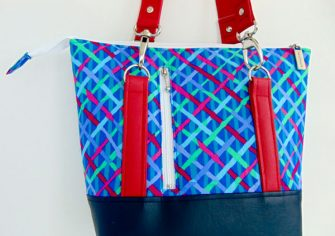 Back view of the blue and red cross hatch Classic Carryall Handbag & Tote - Andrie Designs