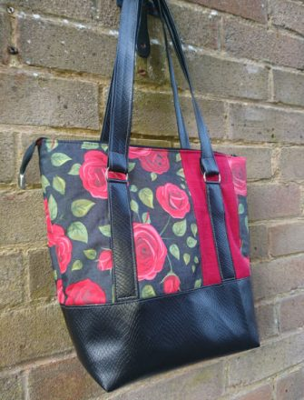 Classic black with red roses Classic Carryall Handbag & Tote - Andrie Designs