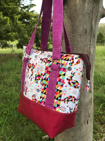 Side view of the geometric print Classic Carryall Handbag & Tote - Andrie Designs