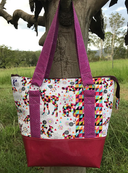 Geometric print paired with magenta and red glitter vinyl Classic Carryall Handbag & Tote - Andrie Designs