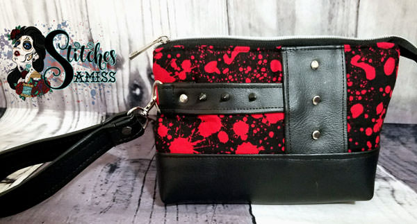 Grunge, rivets and blood make up this Classic Clutch! - Andrie Designs
