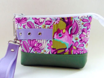 Check out this darling purple Tula Pink-themed Classic Clutch - Andrie Designs