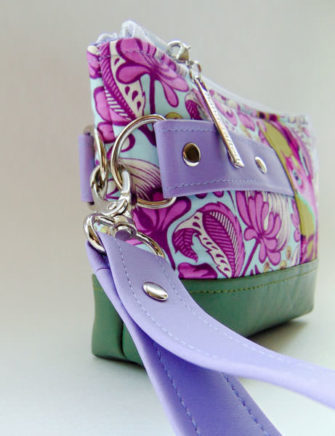Side view of the purple Tula Pink-themed Classic Clutch - Andrie Designs