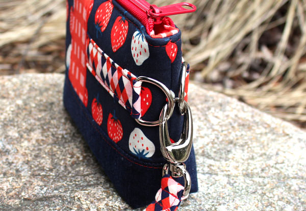 Side view of the strawberry-themed Classic Clutch - Andrie Designs