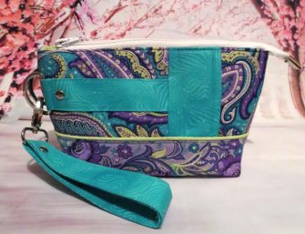Love this purple and teal Classic Clutch - Andrie Designs