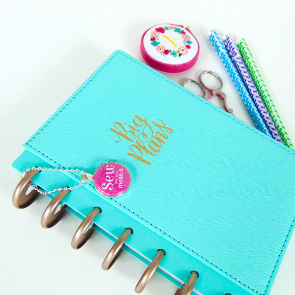 Fuchsia swing tag helps adorn this planner! Andrie Adornments