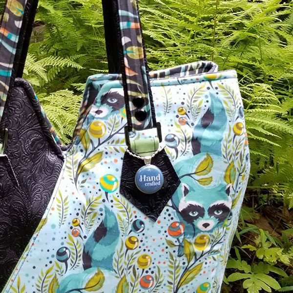 Navy swing tag on a beautiful handmade bag - Andrie Adornments