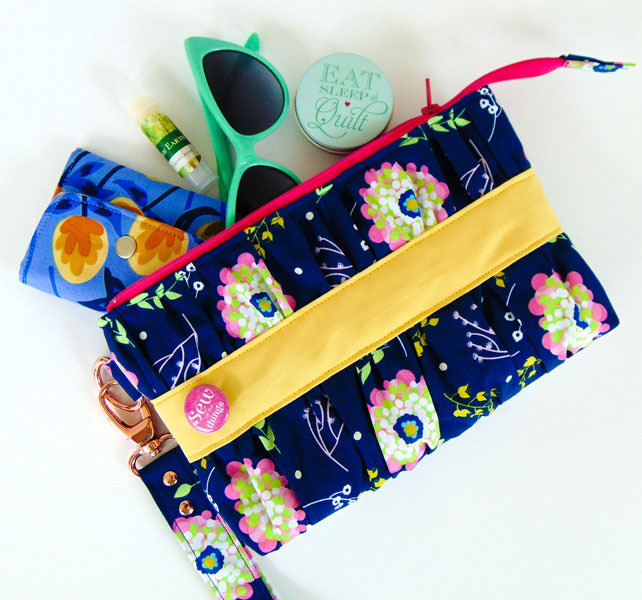 Navy floral with a pop of yellow Gather Me Up Clutch - Andrie Designs