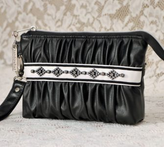 Classy black faux leather Gather Me Up Clutch - Andrie Designs