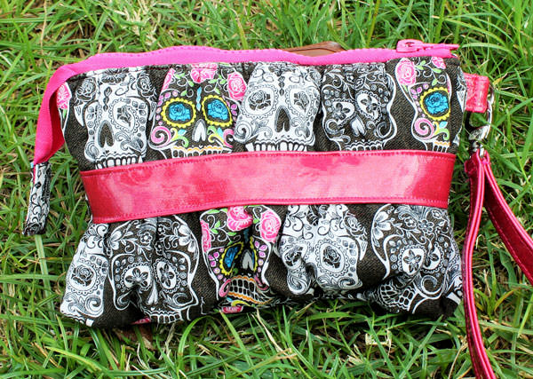 Sugar skulls adorn this Gather Me Up Clutch - Andrie Designs