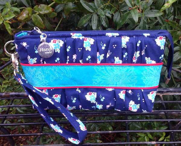 Blue floral with a pop of red Gather Me Up Clutch