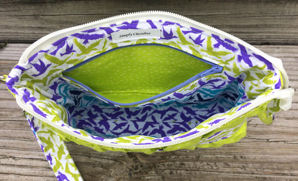 Inside the lime green Gather Me Up Clutch - Andrie Designs