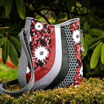 It's classic black, grey and red for this Shades of Yesterday Tote Bag - Andrie Designs