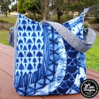 Shades of blue make up this Shades of Yesterday Tote Bag - Andrie Designs