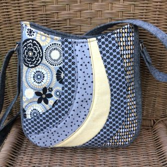 Pastel blues and yellows make up this Shades of Yesterday Tote Bag - Andrie Designs