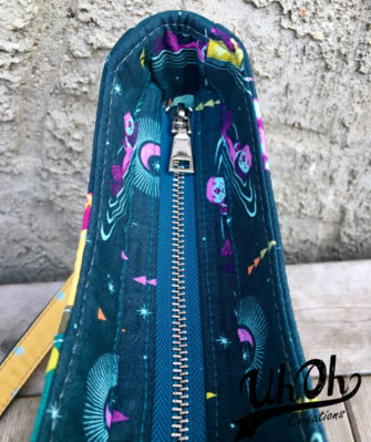 A recessed zipper closes the Shades of Yesterday Tote Bag - Andrie Designs