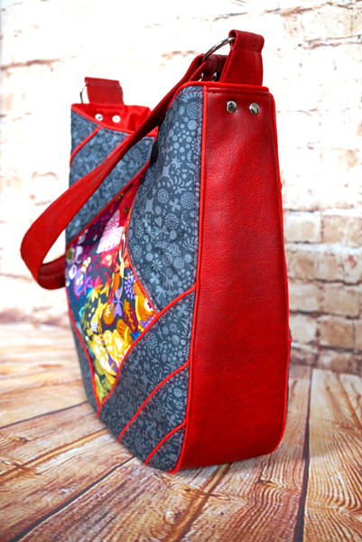 Side view of the Alison-Glass-themed with red piping Feature Me Everyday Tote - Andrie Designs