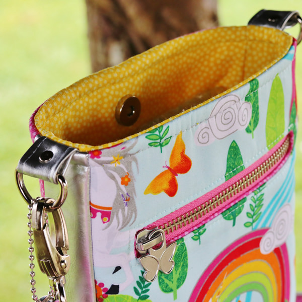 Simple magnetic snap closure on the Mini Shades Pouch - Andrie Designs