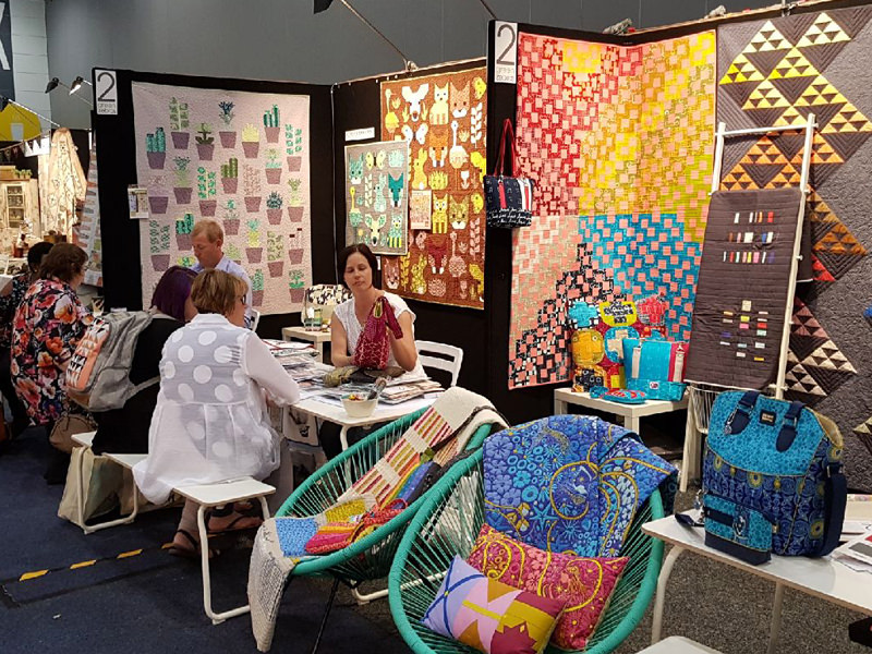 Lisa doing business at AQM 2017 - Andrie Designs