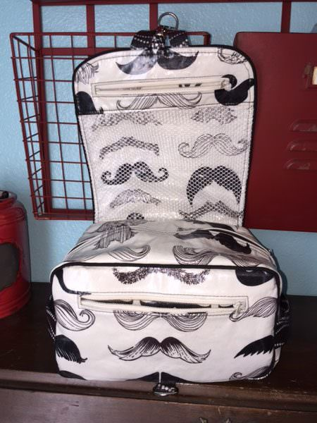 Inside the moustache-themed Hang About Toiletry Bag - Andrie Designs