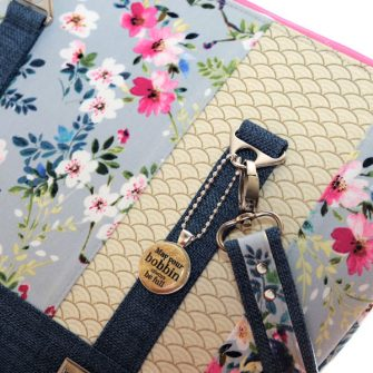 Gold on silver swing tag on a beautiful Classic Carryall - Andrie Adornments