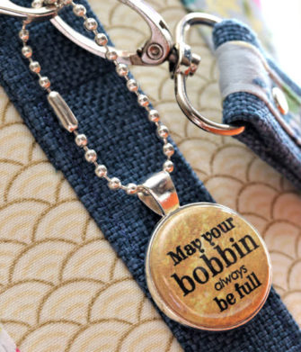 Close up of a gold on silver swing tag - Andrie Adornments