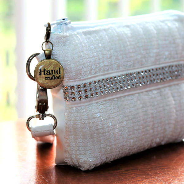 Gorgeous gold on antique brass zipper pull on a stunning Gather Me Up Clutch - Andrie Adornments