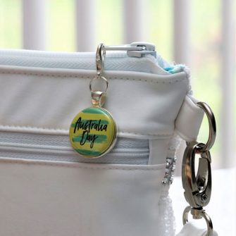 Green and Gold adornment on silver zipper pull - Andrie Adornments