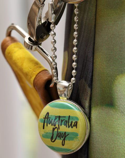 Green and Gold adornment on silver swing tag - Andrie Adornments