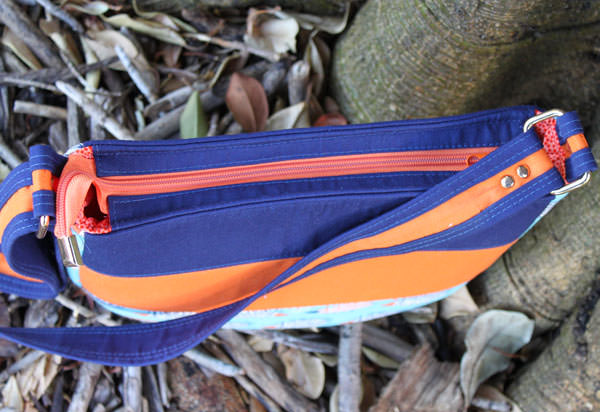 Top zipper of the orange, navy and hedgehogs Summertime Sling - Andrie Designs